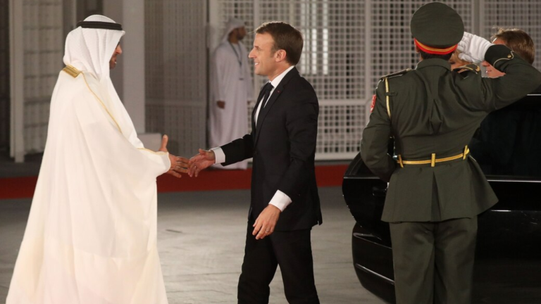 Abu Dhabi Crown Prince Mohammed bin Zayed Al-Nahyan, left, greets French President Emmanuel Macron on Nov. 8, 2017, on Saadiyat island in the Emirati capital. (Ludovic Marin/AFP via Getty Images)